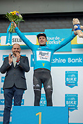 Jesper Asselman of Roompot - Charles winner of stage 1 of the 2019 Tour de Yorkshire on podium wearing the overall general classification blue jersey for stage winner presentation during the first stage of the Tour de Yorkshire from Doncaster to Selby, Doncaster, United Kingdom on 2 May 2019.