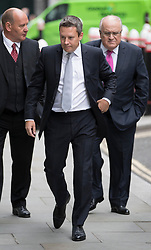 © Licensed to London News Pictures. 03/07/2017. Financier  David Rowland (R) arrives at the High Court with his son, also a financier, Jonathan Rowland (C). Photo credit: Peter Macdiarmid/LNP