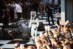 March 17, 2019 - Albert Park, VIC, U.S. - ALBERT PARK, VIC - MARCH 17: A happy Mercedes-AMG Petronas Motorsport driver Valtteri Bottas (77) after his race win at The Australian Formula One Grand Prix on March 17, 2019, at The Melbourne Grand Prix Circuit in Albert Park, Australia. (Photo by Speed Media/Icon Sportswire) (Credit Image: © Steven Markham/Icon SMI via ZUMA Press)