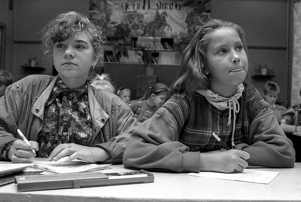 Two female students in class.<br /> Admiraltiskii Rayon Area<br /> School number 235<br /> St Petersburg, Russia 1994