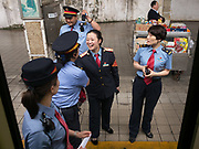 Controler Staff for the train jokes with local station staff from Changsha. Life in the train from Hong Kong to Urumqi (Xinjiang).
