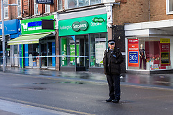 © Licensed to London News Pictures. 14/12/2020. HARROW, UK. Police officers in Station Road. A man, believed to be in his 20s, has died and two others, believed to be in their late-teens, have been injured in a stabbing Station Road in Harrow, north west London. The Met Police said emergency services were called to the area at 19:15 GMT on Sunday 13 December to reports of a stabbing.  A crime scene remains in place.  Photo credit: Stephen Chung/LNP