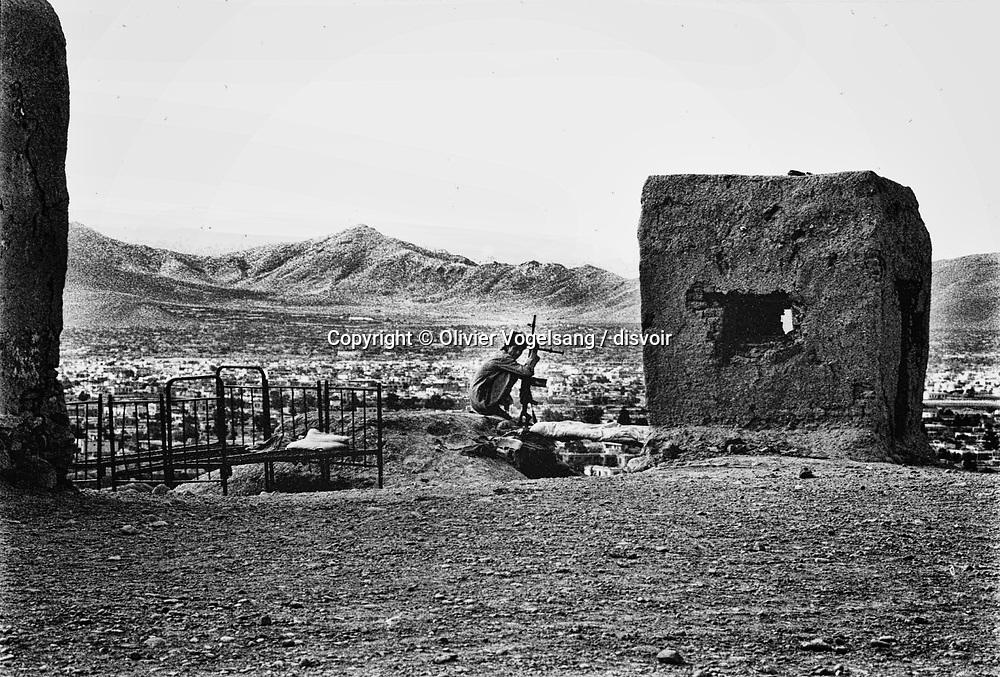 Afghanistan. Kabul. Young mujahid on a position overhanging Kabul.