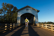 USA, Oregon, Scio, a cyclist crossing the Gilkey Bridge first thing in the morning. MR