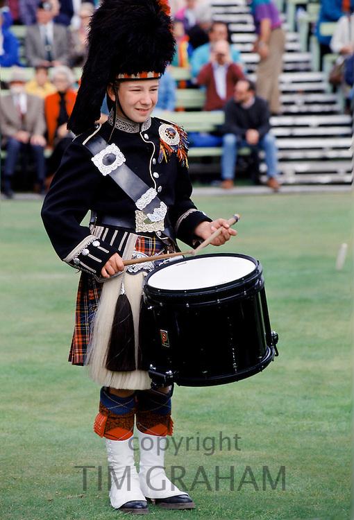 Traditional Scottish drummer in kilt, bearskin and sporran at the Braemar Royal Highland Gathering, the Braemar Games in Scotland
