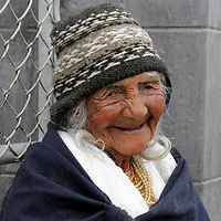 South America, Ecuador, Calderon. Smiling elderly Quechuan woman in Calderon, a small Andean town outside of Quito.