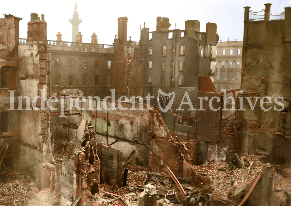 Interior shot of the ruins of the Metropole Hotel at the junction of Sackville (O'Connell) St and Princes St. The GPO is visible to the left and Nelsons Pillar is visible in the background.<br /> (Part of the Independent Newspapers Ireland/NLI Collection) Colourised by Tom Marshall (PhotograFix).