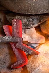 Red hot branding iron