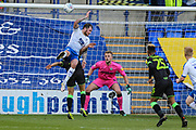 Forest Green Rovers Liam Shephard(2) and Tranmere Rovers James Norwood(10) jump for the ball during the EFL Sky Bet League 2 play off first leg match between Tranmere Rovers and Forest Green Rovers at Prenton Park, Birkenhead, England on 10 May 2019.