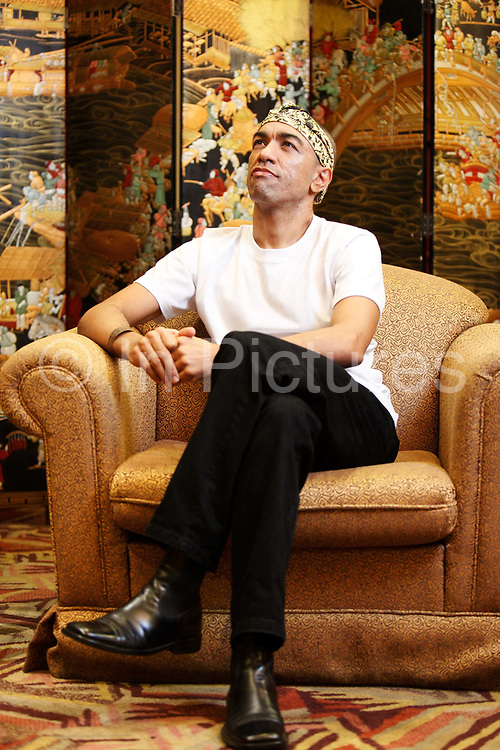 """Mark Ndesandjo, half brother of U.S. president Barrack Obama, speaks during an interview in Shenzhen, China on 09 November 2009. Ndesandjo, who shares the same father with Obama, currently lives in China and married to a Chinese woman, he has written a book titled """"From Nairobi to Shenzhen""""."""