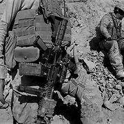 """Sep 09, 2009 - Golestan, Farah Province, Afghanistan - A US Marine from the 2nd MEB of the 2/3 Marines stands watch as two Air Force engineers plant explosives to destroy a Taliban rocket found after fighting in the Black Pass in a hostile region by the Buji Bast Pass (aka Bhuji Bast) and """"Fighting Mountain"""" aka """"Kohe Tengay"""" which in Pashto means """"Three Kings""""  in Golestan, Farah Province, where US Marines have been deadlocked in a bitter counterinsurgency campaign and conflict with insurgents using mainly Improvise Explosive Devices (IED's).<br /> (Credit Image: © Louie Palu/ZUMA Press)"""