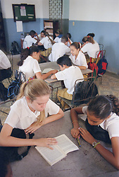 Secondary school children studying in classroom,