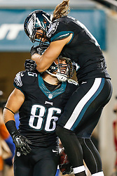 Philadelphia Eagles wide receiver Riley Cooper #14 congratulates tight end Zach Ertz #86 after Ertz scored a touchdown during the NFL game between the New York Giants and the Philadelphia Eagles at Lincoln Financial Field in Philadelphia on Sunday October 12th 2014. The Eagles won 27-0. (Brian Garfinkel/Philadelphia Eagles)