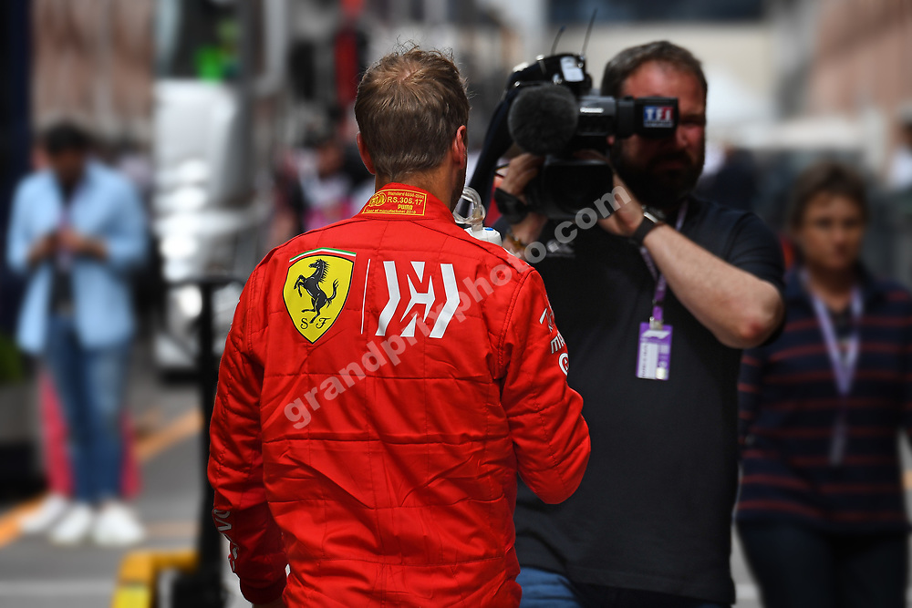Sebastian Vettel (Ferrari) and TV camara man after practice before the 2019 Monaco Grand Prix. Photo: Grand Prix Photo
