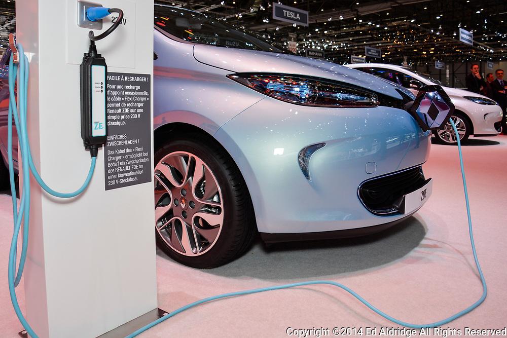 GENEVA, SWITZERLAND - MARCH 4, 2014: Renault ZOE EV and charging station on display during the Geneva Motor Show.