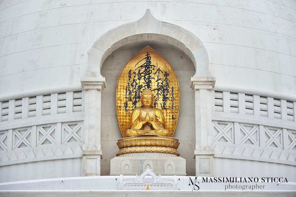 Vishwa Shanti Stupa is a major tourist attraction at Rajgir. Rajgir is a popular pilgrim destination for Buddhists. Nichidatsu Fujii (1885-1985), a Buddhist monk from Japan and founder of the Nipponzan-Myohoji Buddhist sect. Nichidatsu Fujii set an example for world peace through Peace Pagodas. In series of establishing peace pagodas world over he established one such peace pagoda at Rajgir which is called Vishwa Shanti Stupa.<br /> A pagoda is a type of stupa which provides equality for worship and gathering at one place for common cause. The Nipponzan-Myohoji sect has been successful in spreading the views of Lord Buddha for peace and harmony among people. These stupa or Japanese Pagoda are excellent example of oriental style of architecture. Though all of the pagodas are not built under the guidance of Nichidatsu Fujji, most of them have been built either under his guidance or under his recommendations. <br /> World Peace Pagoda at Rajgir is made of spotless white marble and is a remarkable monument. Vishwa Shanti Stupa is the tallest peace Pagoda in the world standing tall at 400 meters and houses four statues of Lord Buddha on the four side-corners of the stupa. <br /> The four statues on four corner-sides of stupa depict the four phases of life of Lord Buddha. These statues are made of gold. These statues depicting, birth, enlightenment, teaching and passing away of Lord Buddha are symbolical of Lord Buddha's teachings and transient life.