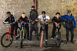 """Left to right, Trizzy, 16, Liam Ross, 17, Mac Ferrari, Pharell """"PJ"""" Samuel, 16, Tevon 'TJ Jules, 13, and Daniel 16,. Bikestormz is the brainchild of leader Mac Ferrari, a group of young trick cyclists who are encouraged to put knives down and enjoy the healthy, positive side of urban youth culture by joining together  and developing their cycling skills. London, September 27 2019."""