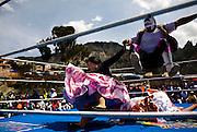 Abril y Mayo 2011/Bolivia<br /> Carmen Rosa La Luchadora de camisa negra al costado izquierdo salta con su compañero luchador el enmascarado para derrotar a la luchadora en el suelo Julia la Paceña<br /> <br /> Foto:Juan Gonzalez
