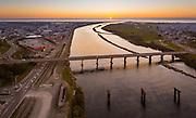 Bridges over the Grey River, and Greymouth CBD, as the sun dips into the Tasman.