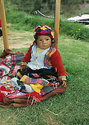 Indigenous child in colourful clothes, Cusco, Peru