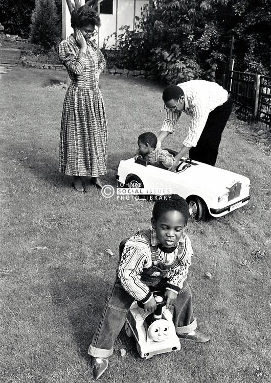 Family in their garden, UK 1988 MR