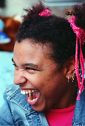 Portrait of young woman with Cerebral Palsy laughing with mouth wide open,