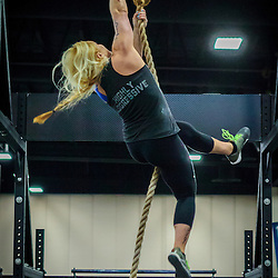 Jaelyn Wolf of Progressive Fitness CrossFit doing rope climb during the second day of competition at the CrossFit Southwest Regionals 2014