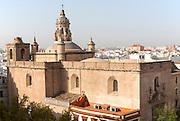 Cityscape view over rooftops the Iglesia de la Anunciación in foreground, Seville, Spain