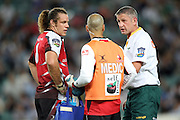 Lions JP Joubert talks with a medic and referee Vinny Munro. Super 14 Rugby Union, Waratahs v Lions, Sydney Football Stadium, Australia. Friday 12 March 2010. Photo: Clay Cross/PHOTOSPORT