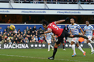 Radamel Falcao of Manchester United attempting a diving header at goal from close range but its saved by QPR keeper Rob Green. Barclays Premier league match, Queens Park Rangers v Manchester Utd at Loftus Road in London on Saturday 17th Jan 2015. pic by John Patrick Fletcher, Andrew Orchard sports photography.