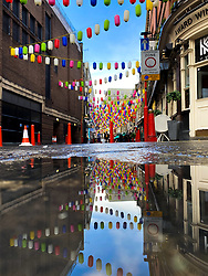 © Licensed to London News Pictures. 25/10/2020. London, UK. The colourful lanterns in London's China Town are part of the #LoveChinatown campaign are reflected in rainwater after overnight rainfall in London. The capital is quieter than normal at the start of the half term holiday, due to the tier two coronavirus restrictions being in place. Photo credit: Dinendra Haria/LNP