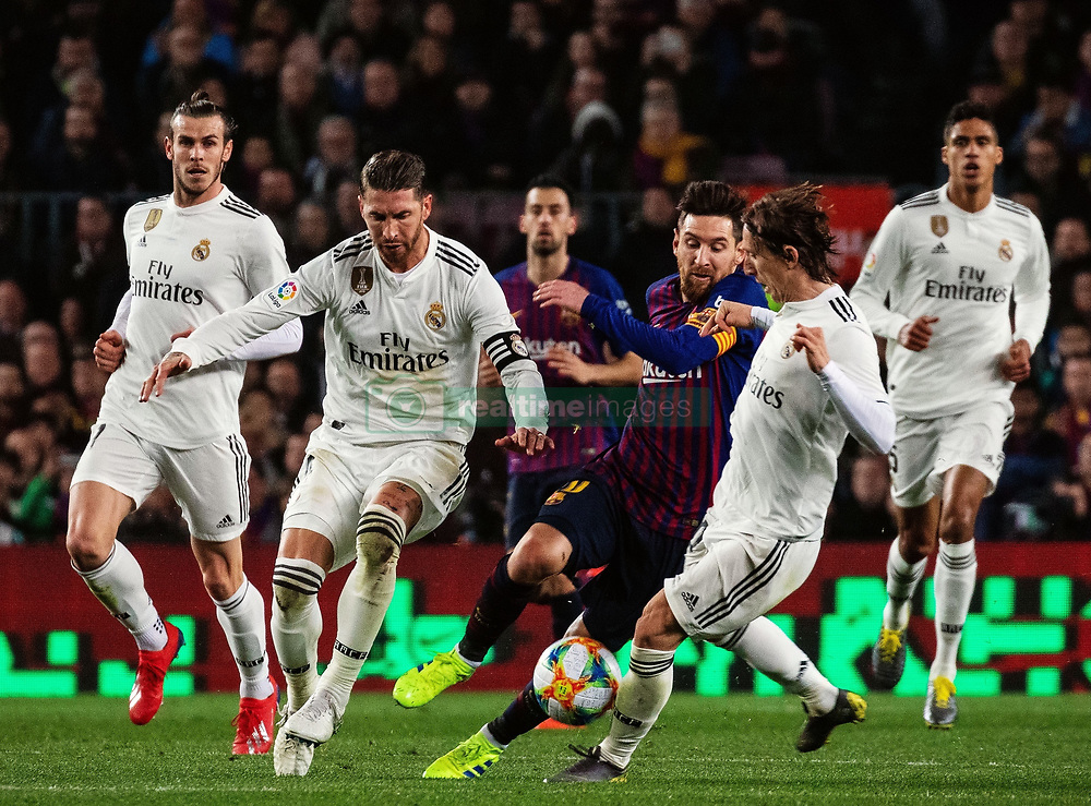 BARCELONA, Feb. 7, 2019  FC Barcelona's Lionel Messi (3rd R) vies with Real Madrid's Luka Modric (2nd R), Sergio Ramos (2nd L) during the Spanish King's Cup semifinal first leg match between FC Barcelona and Real Madrid in Barcelona, Spain, on Feb. 6, 2019. The match ended with a 1-1 draw. (Credit Image: © Joan Gosa/Xinhua via ZUMA Wire)