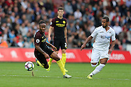 Raheem Sterling of Manchester city (l) in action.Premier league match, Swansea city v Manchester city at the Liberty Stadium in Swansea, South Wales on Saturday 24th September 2016.<br /> pic by Andrew Orchard, Andrew Orchard sports photography.