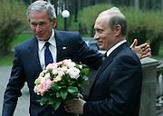 Novo-Ogarevo, Russia, 08/05/2005..Russian President Vladimir Putin greets President of the USA George Bush.