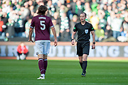 Referee Willie Collum speaks with Peter Haring (#5) of Heart of Midlothian during the Betfred League Cup semi-final match between Heart of Midlothian FC and Celtic FC at the BT Murrayfield Stadium, Edinburgh, Scotland on 28 October 2018.