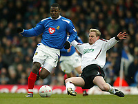 Photo: Scott Heavey.<br /> Portsmouth v Liverpool. FA Cup 5th Round replay. 22/02/2004.<br /> Ayegbeni is tackled by Stephane Henchoz
