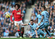 Marouane Fellaini of Manchester United plays the ball under pressure from James Milner of Manchester City - Barclays Premier League - Manchester City vs Manchester Utd - Etihad Stadium - Manchester - England - 2nd November 2014  - Picture David Klein/Sportimage