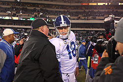 PHILADELPHIA - NOVEMBER 7: Quarterback Peyton Manning #18 of the Indianapolis Colts shakes hands with head coach Andy Reid of the Philadelphia Eagles after a game on November 7, 2011 at Lincoln Financial Field in Philadelphia, Pennsylvania. The Eagles won 26-24. (Photo by Hunter Martin/Getty Images) *** Local Caption *** Peyton Manning;Andy Reid