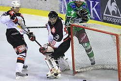 Miha Rebolj, Goalkeeper of Jesenice Gaber Glavic and Nik Zupancic at 39th Round of EBEL League ice hockey match between HDD Tilia Olimpija and HK Acroni Jesenice, on December 30, 2008, in Arena Tivoli, Ljubljana, Slovenia. Tilia Olimpija won 4:3. (Photo by Vid Ponikvar / SportIda).