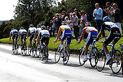 UK, September 15 2011: Rabobank's Lars Boom (gold jersey) follows Mark Cavendish and his HTC team as the the peloton races across Woodbury Common towards the finish in Exmouth during the fifth stage of the 2011 Tour of Britain. The stage started in Exeter and finished in Exmouth. Copyright 2011 Peter Horrell