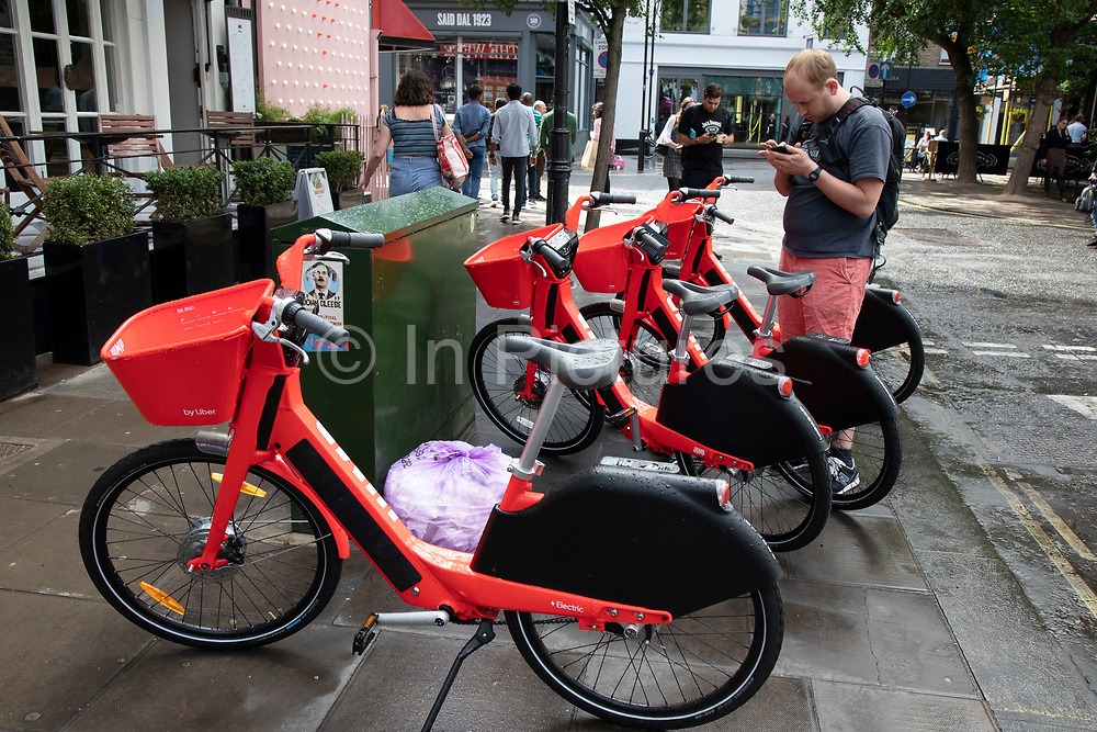 Jump dockless bike sharing electric cycle in London, England, United Kingdom. Social Bicycles Inc., doing business as Jump, is a dockless scooter and electric bicycle sharing system operating in the United States, Germany, Portugal and the United Kingdom. The bikes are a bright red orange. They can be located using the Jump or Uber apps, and users are charged to their Uber account.