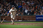 San Francisco Giants catcher Buster Posey (28) runs to first base after a hit against the Pittsburgh Pirates at AT&T Park in San Francisco, California, on July 25, 2017. (Stan Olszewski/Special to S.F. Examiner)