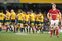 © Licensed to London News Pictures. 16/06/2012. Etihad Stadium, Melbourne Australia. Welsh player Bradley Davies has his hands on his hips after the narrow loss, as the Australian celebrate in the background during the 2nd Rugby Test between Australia Wallabies Vs Wales . Photo credit : Asanka Brendon Ratnayake/LNP
