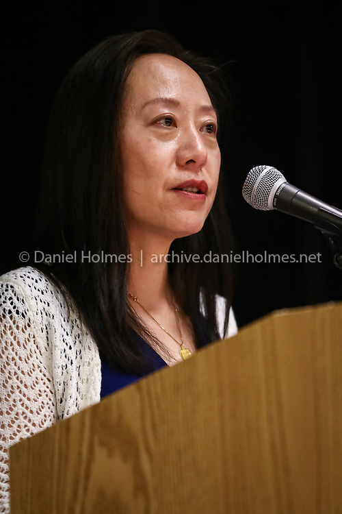 (4/20/16, WESTON, MA) Candidate for School Committee, Tricia Liu, speaks to residents during the Weston League of Women Voters Candidates' Night at Weston Middle School on Wednesday. Daily News and Wicked Local Photo/Dan Holmes