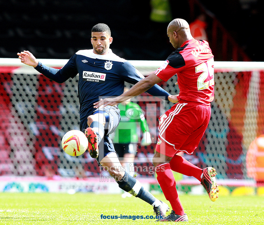 Picture by Paul Terry/Focus Images Ltd +44 7545 642257.27/04/2013.Marvin Elliott of Bristol City and Oscar Gobern of Huddersfield in action Town during the npower Championship match at Ashton Gate, Bristol.