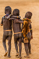 Young Hamer tribe boys walking arm in arm, Omo Valley, Ethiopia.