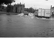 """Flooding at the Dodder..1986..226.08.1986..08.26.1986..28th August 1986..As a result of Hurricane Charly (Charlie) heavy overnight rainfall was the cause of severe flooding in the Donnybrook/Ballsbridge areas of Dublin. In a period of just 12 hours it was stated that 8 inches of rain had fallen. The Dodder,long regarded as a """"Flashy"""" river, burst its banks and caused great hardship to families in the 300 or so homes which were flooded. Council workers and the Fire Brigades did their best to try and alleviate some of the problems by removing debris and pumping out some of the homes affected..Note: """"Flashy"""" is a term given to a river which is prone to flooding as a result of heavy or sustained rainfall...Vans and trucks cause a small tidal wave as they negotiate the flood waters."""