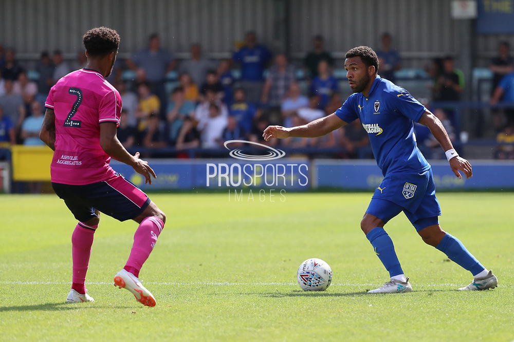 AFC Wimbledon striker Andy Barcham (17) taking on Queens Park Rangers defender Darnell Furlong (2) during the Pre-Season Friendly match between AFC Wimbledon and Queens Park Rangers at the Cherry Red Records Stadium, Kingston, England on 14 July 2018. Picture by Matthew Redman.