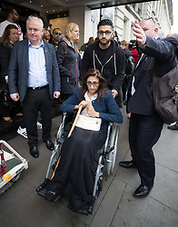 © Licensed to London News Pictures. 14/09/2017. London, UK. Grenfell resident Flora Neda is pushed in a wheelchair by her relative Raby Seied outside The Connaught Rooms on the first day of the public inquiry into the Grenfell fire. Police say they believe 80 people died in the tragedy. Photo credit: Peter Macdiarmid/LNP