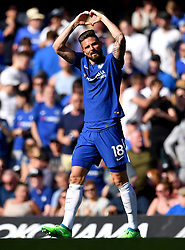 Chelsea's Olivier Giroud celebrates scoring his side's first goal of the game during the Premier League match at Stamford Bridge, London.